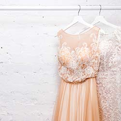 Copy space Wedding dresses for the bride on hangers against a wh